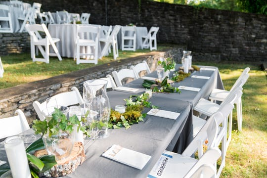 Foraged rocks and ivy, moss and upcycled glass bowls, vases and other containers made easy, affordable and eco-friendly reception centerpieces at Brittany Crocker's 2018 wedding.