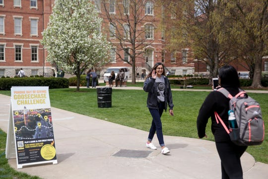 Soukhya Inamdar, center, a junior selling and sales management student poses for a photo for Poshitha Bandarupalli, a junior electrical engineering major participate in the Goosechase challenge during the sixth annual Purdue Day of Giving, Wednesday, April 24, 2019, at Purdue University in West Lafayette. Purdue raised $37.6 million during last year's Day of Giving, making it a leader in higher ed one-day campaigns for a fourth straight year.