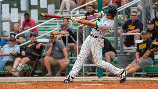 Xan Saunier at the plate as Lafayette High takes on St Amant Baseball. Tuesday, April 23, 2019.
