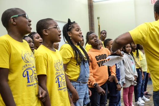 Musicians from Martinique prep the exchange students for their singing performance at Festival International on April 28, 2019.