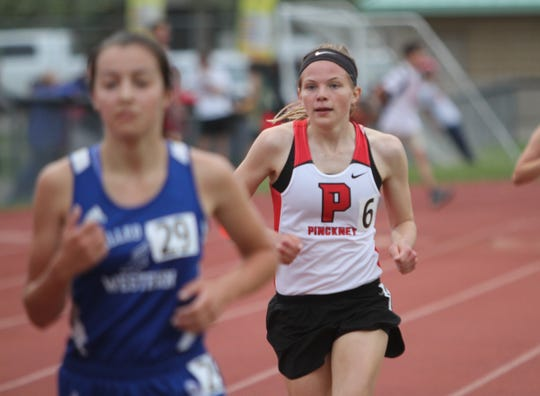 Pinckney's Noelle Adriaens (6) won the 1,600 and 3,200 in a tri meet against Adrian and Dexter.
