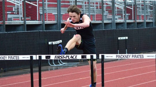 Pinckney's Dylan Deck swept the hurdles in a tri meet against Adrian and Dexter.