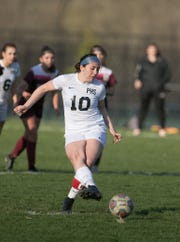 Cassandra Bonifas of Pinckney makes the first of her two goals on a penalty kick in a 2-2 tie at Dexter on Tuesday, April 23, 2019.