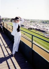 Courier Journal reporter Kristina Goetz standing on the rooftop at Churchill Downs covering her first Kentucky Derby in 1999.