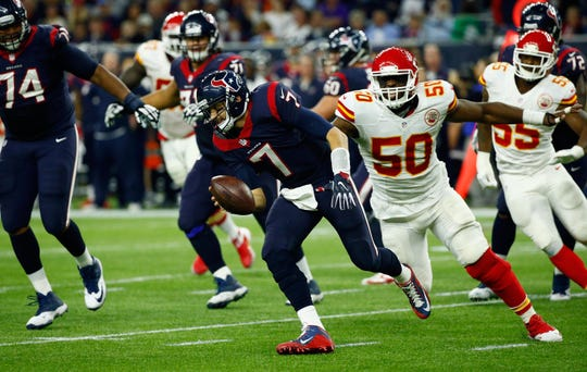 Quarterback Brian Hoyer #7 of the Houston Texans scrambles against Justin Houston #50 of the Kansas City Chiefs in the third quarter during the AFC Wild Card Playoff game at NRG Stadium on January 9, 2016 in Houston, Texas.