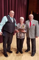 Clipper City Chordsmen recently honored Terry Burbey-Schemlzle with the Harmony Award. Pictured from left are Chordsmen President David Rabe, Burbey-Schmelzle and Chordsmen Past President Ron Krupski.
