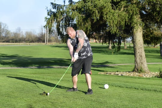 Richard Kovach, of Bucyrus, muscles a big drive at Valley View Golf Course outside Galion.
