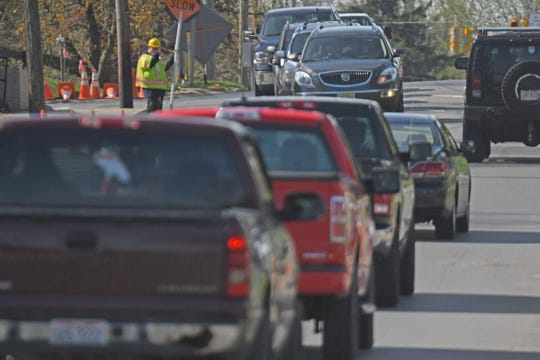 Flaggers control traffic flow Wednesday morning on South Main Street near Cameron Avenue.