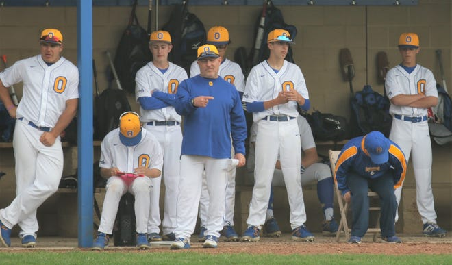 Ontario's Mike Ellis gives a sign from the dugout during a 2019 game against Clear Fork. Ellis was named the new head baseball coach of Ontario after serving five seasons as the Warriors' pitching coach.