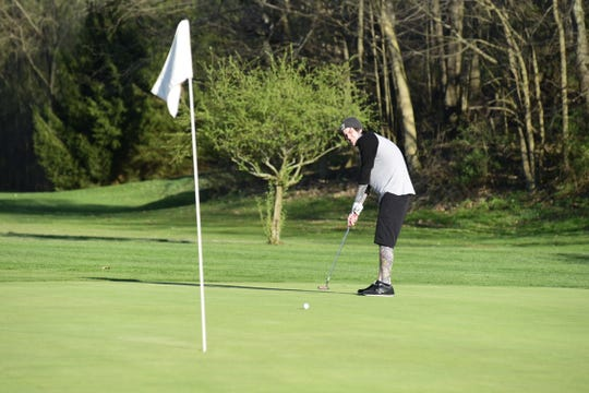 Matt Rister, of Bucyrus, attempts to sink a putt this week at Valley View Golf Course outside Galion.