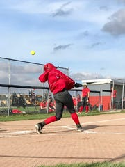 Elgin softball player Bekah Muselin takes a swing during a game against Upper Scioto Valley last season. Muselin is a senior and her mother Wendy Muselin is the longtime head coach.