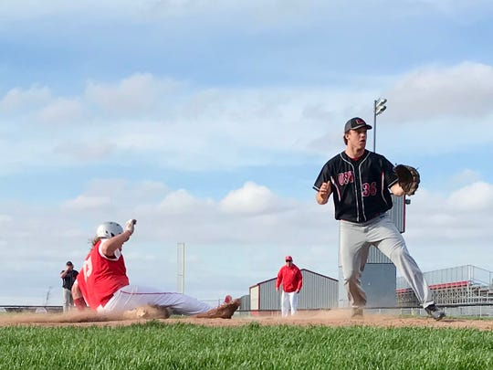Elgin's Kecher Clark slides into home plate during a 2019 high school baseball game against Upper Scioto Valley.