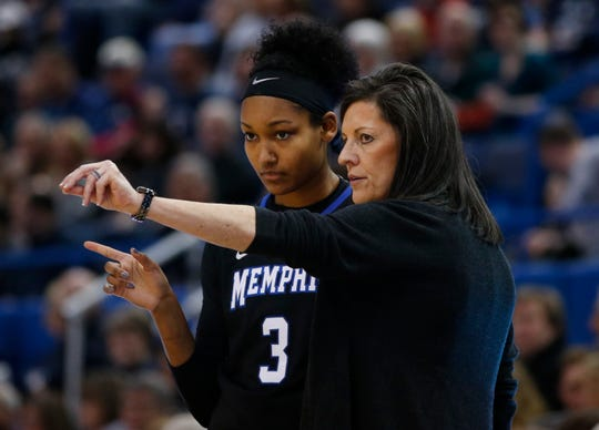 Jan 30, 2016; Hartford, CT, USA; Memphis Tigers head coach Melissa McFerrin talks with guard Taylor Williams (3) in the first half against the Connecticut Huskies at XL Center. UConn defeated Memphis 83-40.