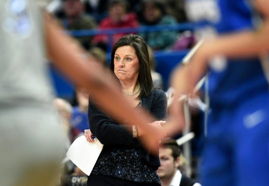 Memphis head coach Melissa McFerrin watches from the sideline during an NCAA college basketball game against Connecticut, Sunday, Dec. 31, 2017, in Hartford, Conn.