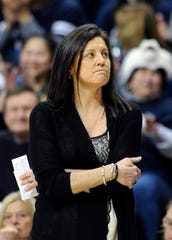 Memphis head coach Melissa McFerrin watches the scoreboard during the first half of an NCAA college basketball game against Connecticut in Storrs, Conn., on Saturday, Feb. 28, 2015.