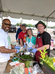 Rotary Club of Memphis volunteers prepare authentic New Orleans Shrimp & Grits and Beignets for their annual Cafe du Monde event.