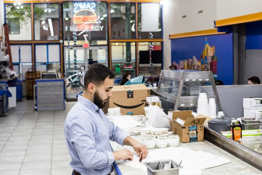 Omar Mustapha preps for the opening of Barbarossa Brothers inside of his father's restaurant, Sam's Main Street Eatery on April 19. The restaurant is Sam's Main Street Eatery during the day and transforms into Barbarossa Brothers in the evening.