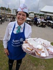 Shali Atkinson serves freshly cooked beignets at Cafe du Memphis.