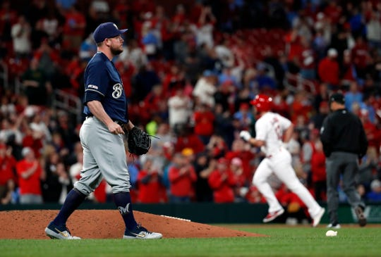 Paul DeJong of the Cardinals  circles the bases as Brewers reliever Alex Wilson tries to collect himself after giving up the go-ahead run in the bottom of the eighth inning Tuesday night.