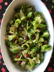 Brussels sprouts leaves are gently sauteed to retain a bit of crunch for this bright spring salad.