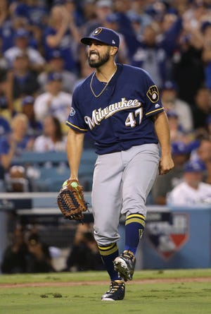 Former Brewers pitcher Gio Gonzalez reacts in pain after suffering a high ankle sprain in Game 4 of the NLCS against the Dodgers in 2018.