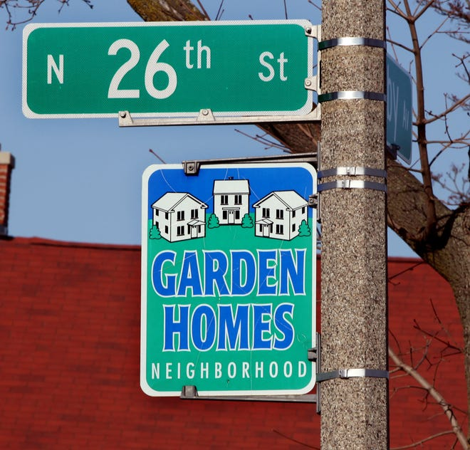 The Garden Homes neighborhood was part of a progressive housing project in the 1920s, but today suffers the twin plagues of abandoned, boarded-up houses and violent crime.
