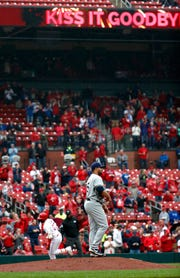 The Cardinals' Marcell Ozuna rounds the bases after hitting a three-run home run off Brewers starting pitcher Jhoulys Chacin in the fourth inning Wednesday.