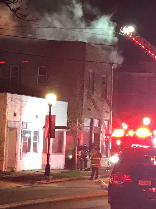 Waukesha firefighters quickly get into position to battle a fire at an old bar building at 854 Martin St. shortly after 9:30 p.m. Tuesday, April 23. The flames could be seen shooting from the roof of the downtown building as the thick smoke filled the streets to the west.