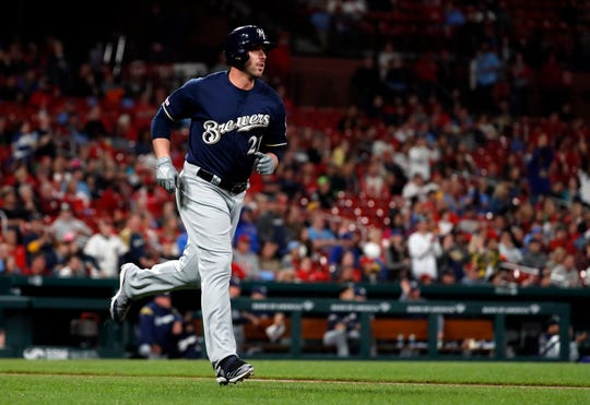 The Brewers' Travis Shaw watches his solo home run during the sixth inning.