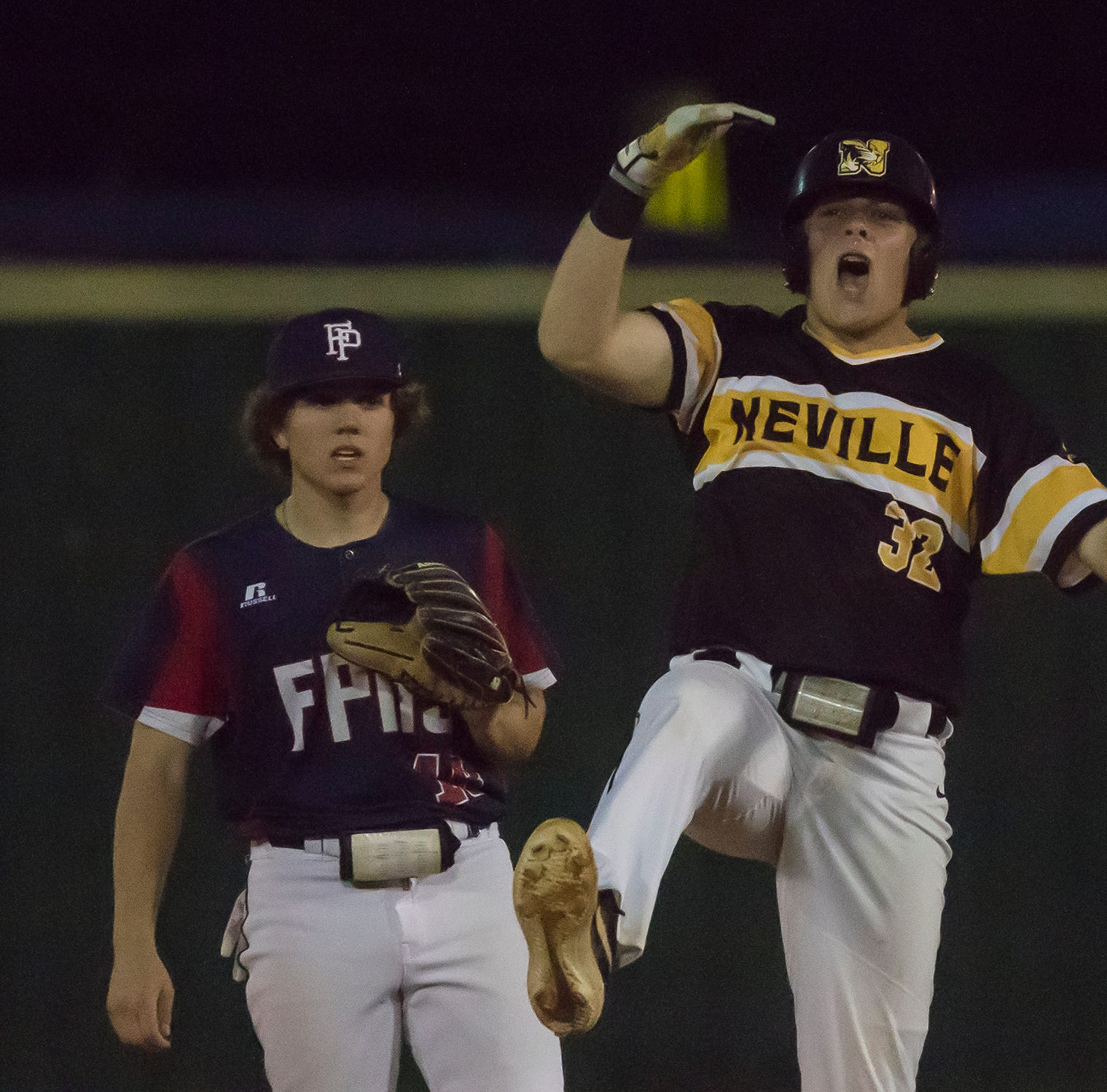 Neville's Parker Fugler (32) celebrates at second base after hitting a double in the bottom of the 7th to move a runner into scoring position during the Class 4A first round playoff game against Franklin Parish at Embanato Field in Monroe, La. on April 23. Neville would win with 5-4 in the bottom of the 7th.