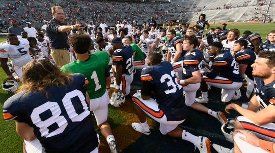 Auburn coach Gus Malzahn talks to his players after A-Day on Saturday, April 13, 2019 in Auburn, Ala.