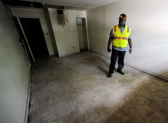 """Renovation worker Rogers Hunt stands in a room once occupied by Martin Luther King Jr. in the old A.G. Gaston Motel in Birmingham, Ala., on Wednesday, April 17, 2019. Once featured in the """"The Negro Motorist Green Book,"""" the long-closed motel provided a home for King during civil rights demonstrations in the 1960s. It is is being transformed into the centerpiece of a new national civil rights monument. (AP Photo/Jay Reeves)"""