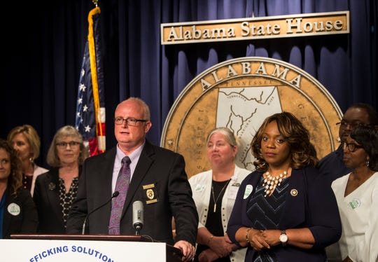 Tuscaloosa Police Department Lt. Darren Beams speaks during a human trafficking legislation press conference at the Alabama State House in Montgomery, Ala., on Saturday, Dec. 31, 2011.