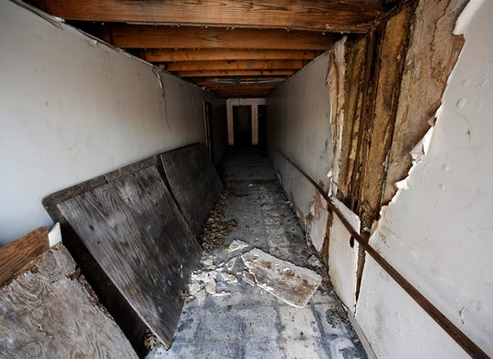 """A littered hallway is shown in the historic A.G. Gaston Motel during renovation work in Birmingham, Ala., on Wednesday, April 17, 2019. Once featured in the """"The Negro Motorist Green Book,"""" the long-closed motel provided a home for Martin Luther King Jr. during civil rights demonstrations in the 1960s. It is is being transformed into the centerpiece of a new national civil rights monument. (AP Photo/Jay Reeves)"""
