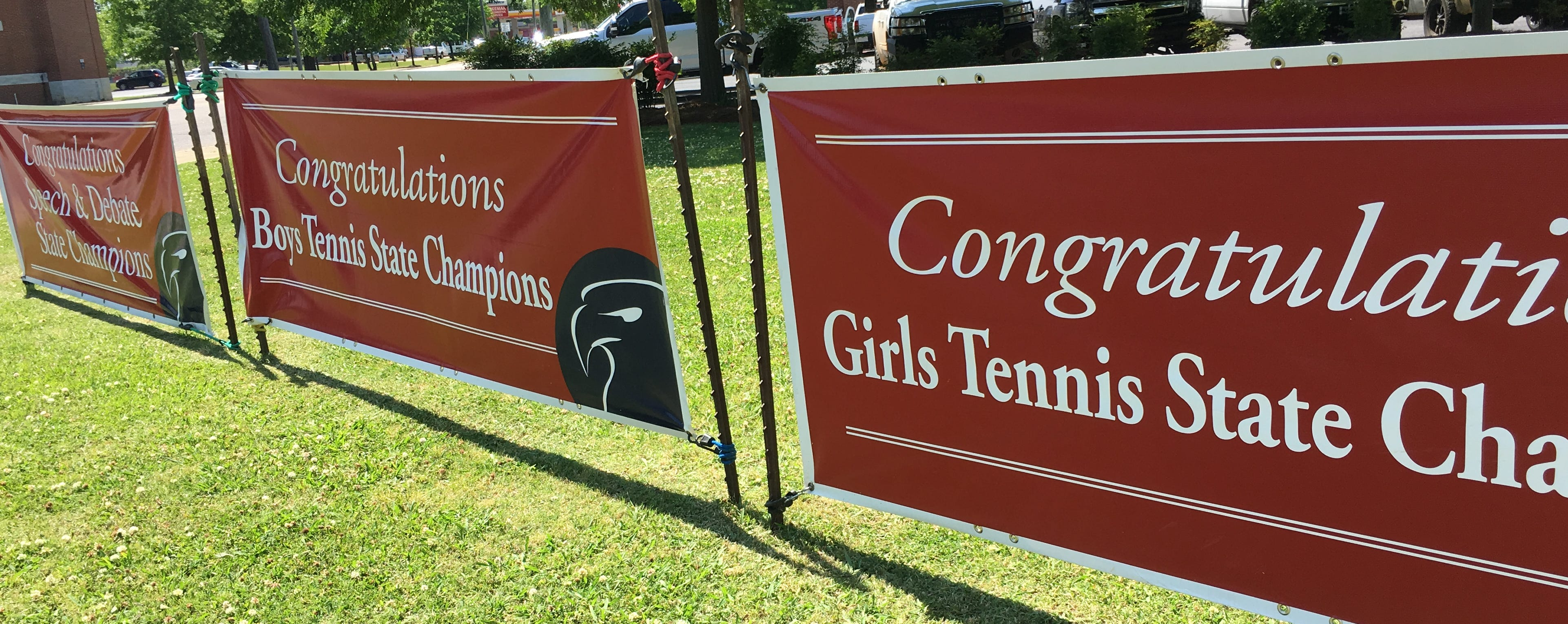 MA hauled out its boys and girls state championship street banners Wednesday to join a recent speech and debate title.