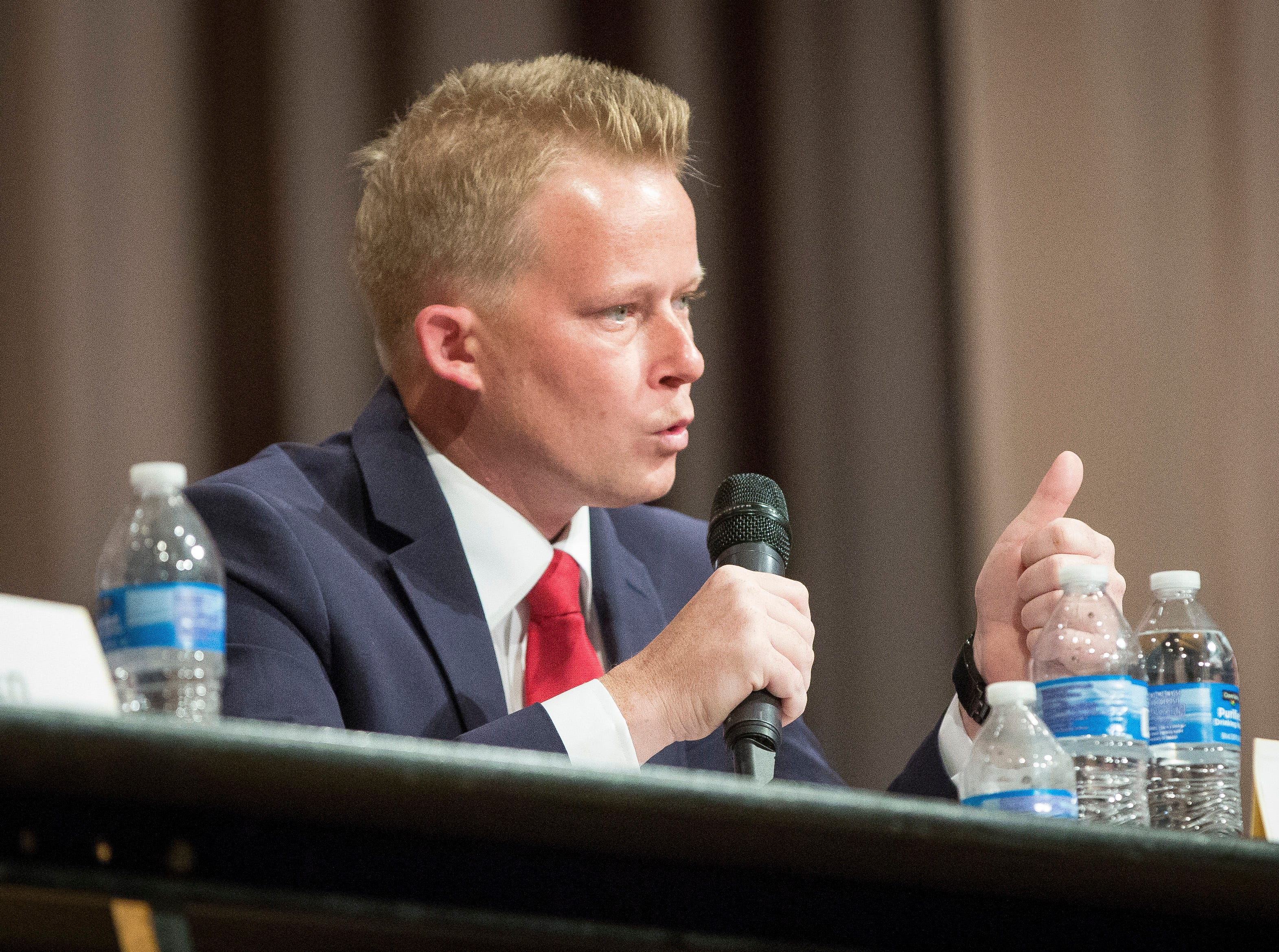 Nate Jones answers a question from the moderators during the Republican mayoral debate on April 23 at Northside Middle School. The primary is on May 7.
