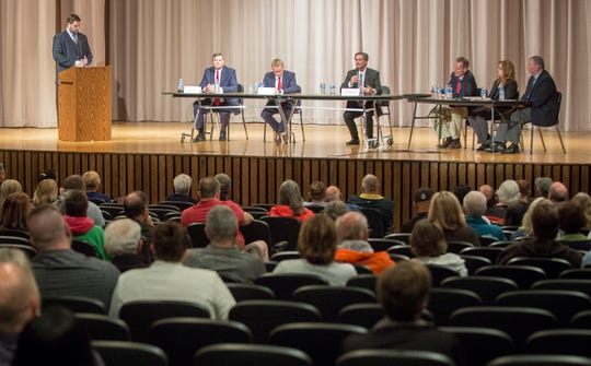 Tom Bracken, Nate Jones and Dan Ridenour answers questions during the Republican mayoral debate on April 23 at Northside Middle School. The primary is on May 7.
