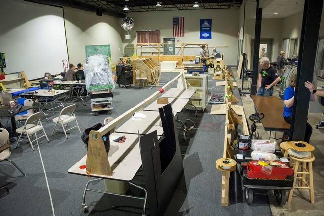 Members of PhyXTGears work on last-minute upgrades to coding and mechanical work before heading to a world championship competition in Detroit, Mich., in this file photo.