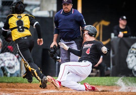 Wapahani's Luke Willmann slides home against Cowan during their game at Cowan High School Wednesday, April 24, 2019.