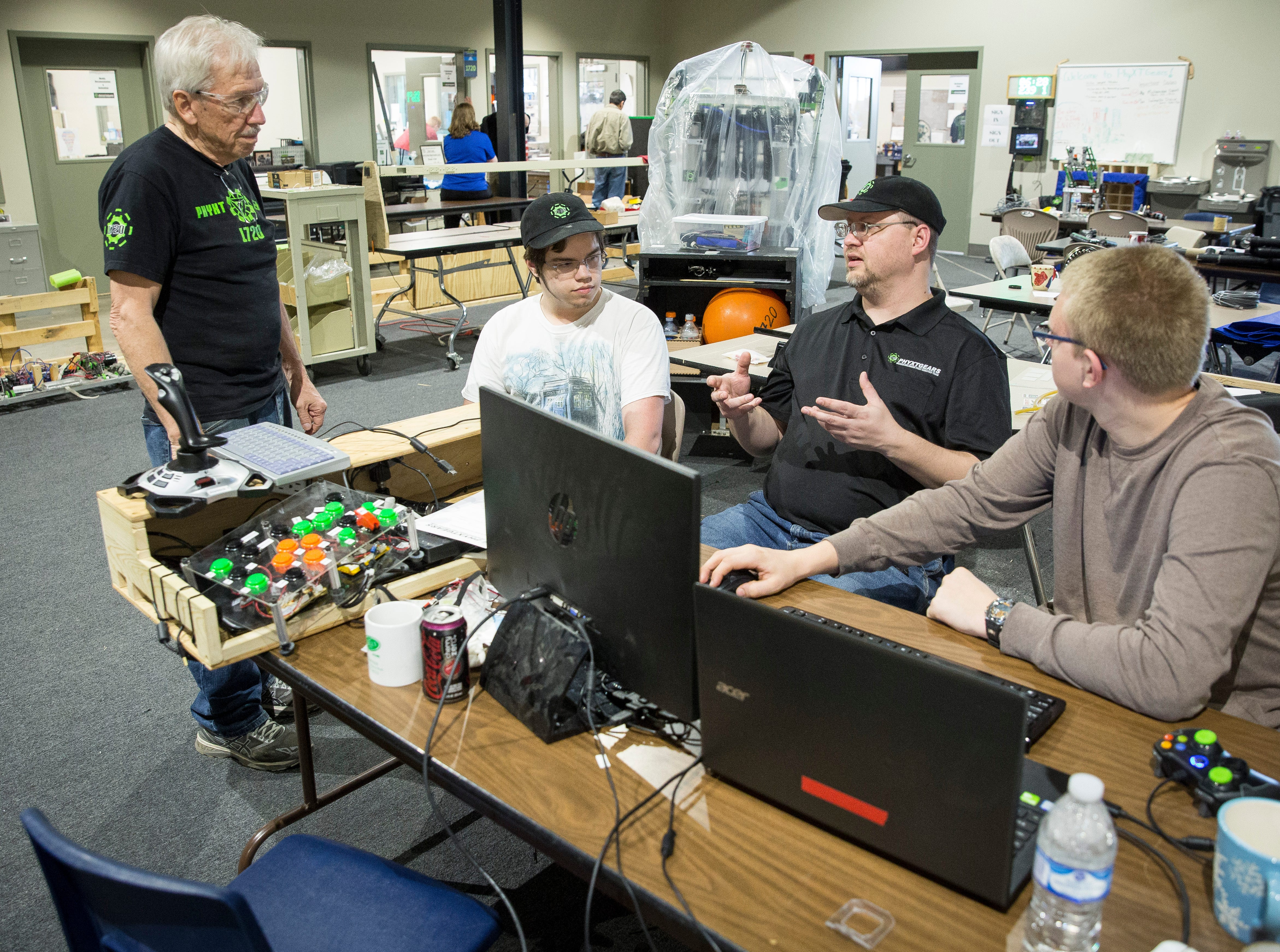 Members of PhyXTGears work on last minute upgrades to coding and mechanical work before heading to the world championship in Detroit Michigan. The group, which works out of Madjax,