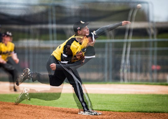 Cowan's Jacob Clark pitches against Wapahani during their game at Cowan High School Wednesday, April 24, 2019.