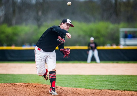 Wapahani's Brevan Rivers pitches against Wapahani during their game at Cowan High School Wednesday, April 24, 2019.