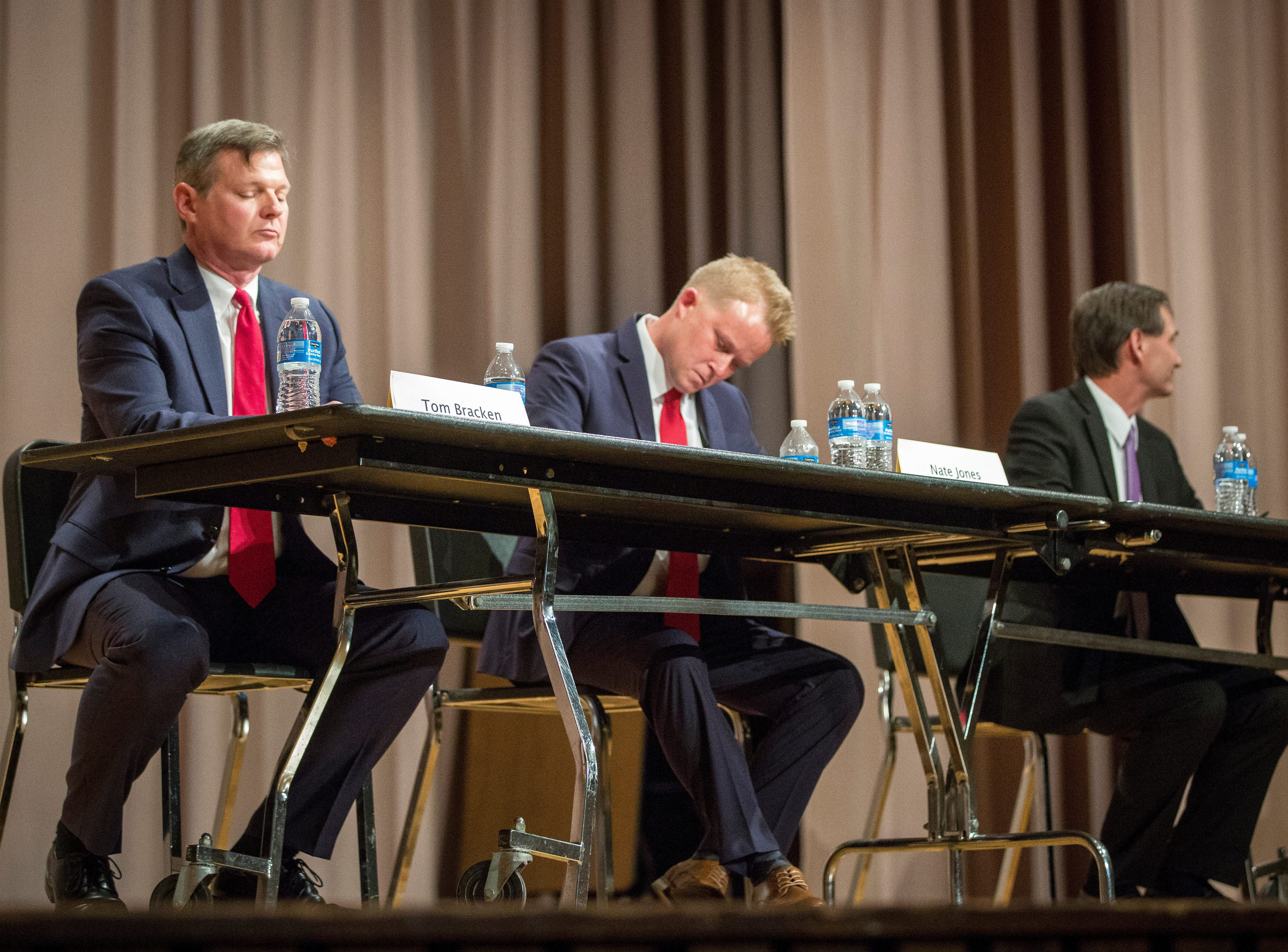 All three candidates prepare their opening statements during the Republican mayoral debate on April 23 at Northside Middle School. The primary is on May 7.