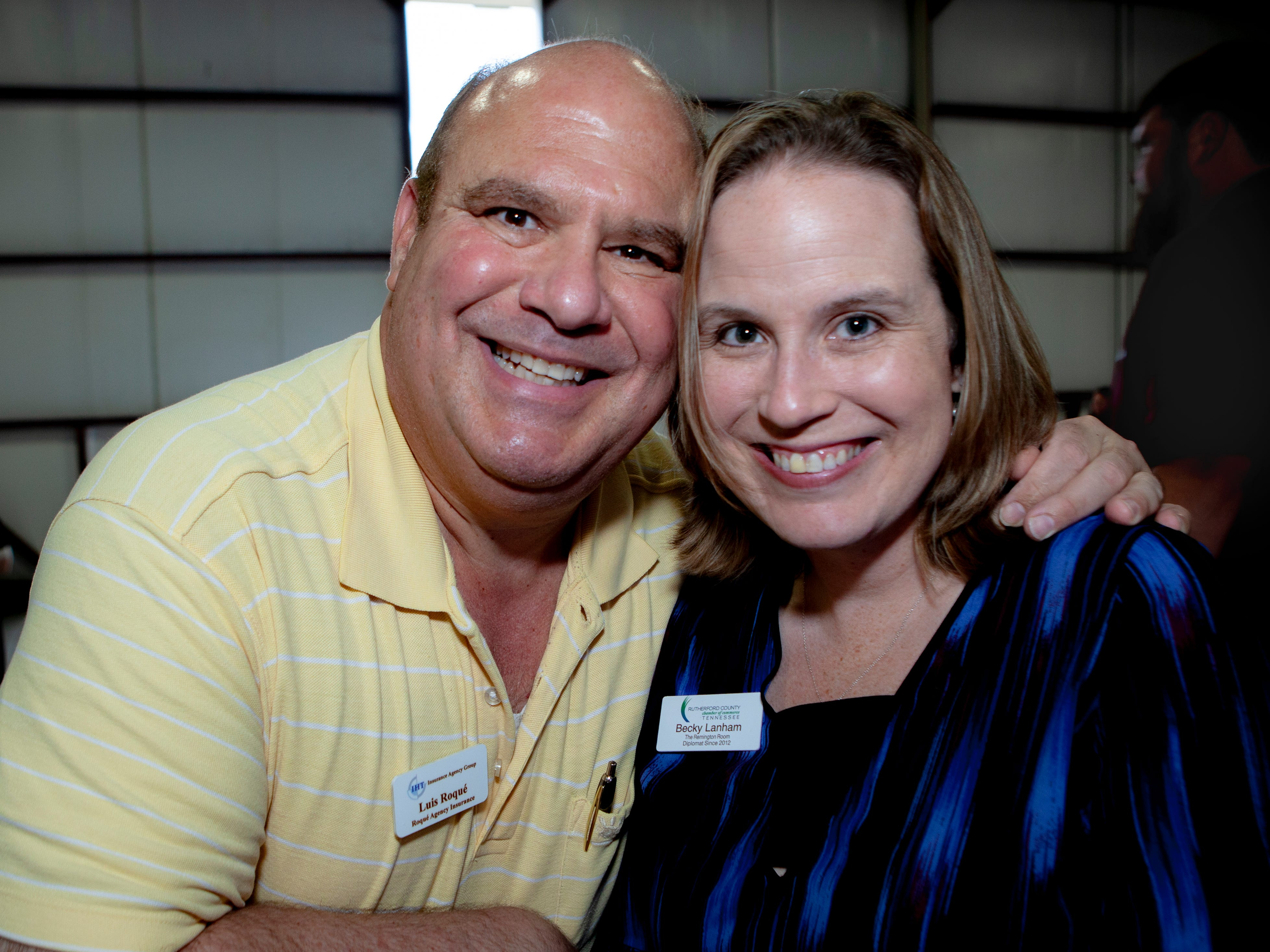 Louis Roque and Becky Lanham at the Light Up Local Firefly Awards, hosted by Locally Owned Murfreesboro and Smyrna Independent Merchants Association. Awards were presented Tuesday, April 23, 2019 at Hollingshead Aviation at Smyrna Airport.
