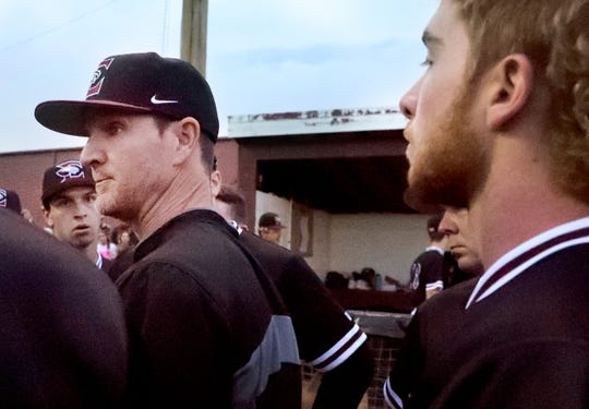 Eagleville's assistant baseball coach Mudcat Brewer talks with the team in a huddle between innings as his son Blake Brewer (17) stands behind him during the game against Cornersville  on Tuesday April 23, 2019, at Eagleville.