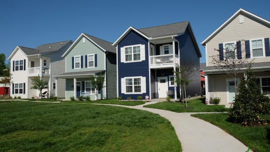 Homes at Village Green come with bright exterior colors and a choice of a second-level porch.