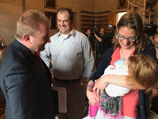 House Majority Leader William Lamberth, R-Portland, greets Adelaide Kauffmann and her parents, Dr. Rhondi Kauffmann and Adam Kauffmann, in the Legislative Library. They were there Wednesday, April 24, 2019, to celebrate the House's passage of a budget that would provide TennCare funding for children with severe disabilities who cannot qualify for state health insurance.