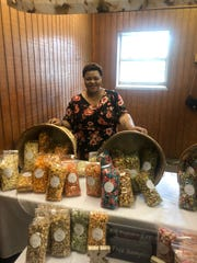 Kaneisha Scott co-owns KB Popcorn with Brenda Dotson. The homemade gourmet popcorn shop is located on East Main Street in Gallatin.