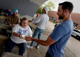 Titans players, cheerleaders and NFL representatives came out to help support Nashville's homeless population on Tuesday evening.