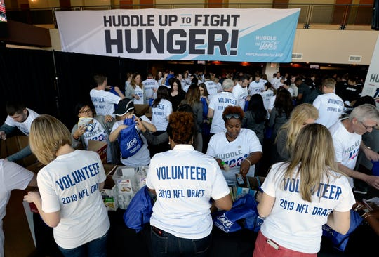 Volunteers assemble food kits in backpacks for children who qualify for hunger relief programs on Wednesday, April 24, 2019 in Nashville, Tenn. The draft prospects, NFL Commissioner Roger Goodell, Tennessee Titans owner Amy Adams Strunk, Nashville Mayor David Briley, Tennessee Titans football players and other volunteers helped during the Huddle Against Hunger backpack assembly coordinated by The Bridge Ministry and Second Harvest food bank. Fairview High School students who won the Middle Tennessee high school football food drive competition also helped assemble the food kits.